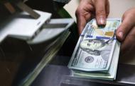 Доллар и евро снизились к рублю на торгах на фоне роста нефти