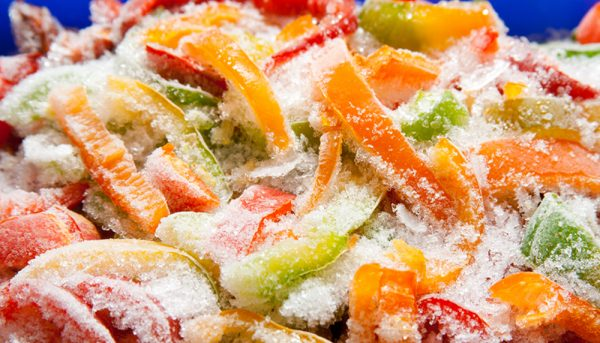 Assortment of frozen vegetables and peppers, closeup
