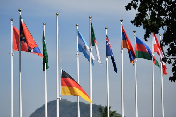 Flag of Germany (C) flies at half mast at the Olympic site of the Riocentro venue in Barra during the Rio 2016 Olympic Games in Rio de Janeiro, Brazil, 16 August 2016. German canoeing coach Stefan Henze has died of injuries suffered in traffic accident in Rio de Janeiro, the country's Olympic sports association DOSB said on 15 August 2016. Photo: Lukas Schulze/dpa